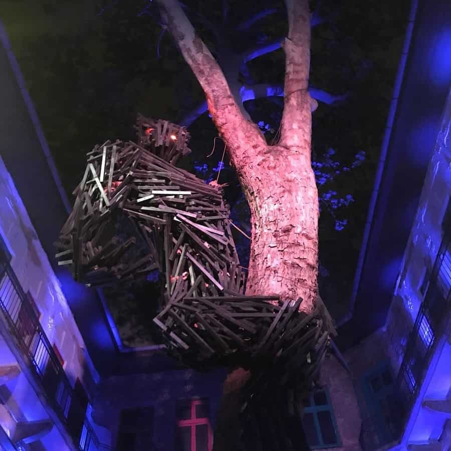 giant red-eyed gorilla made from logs